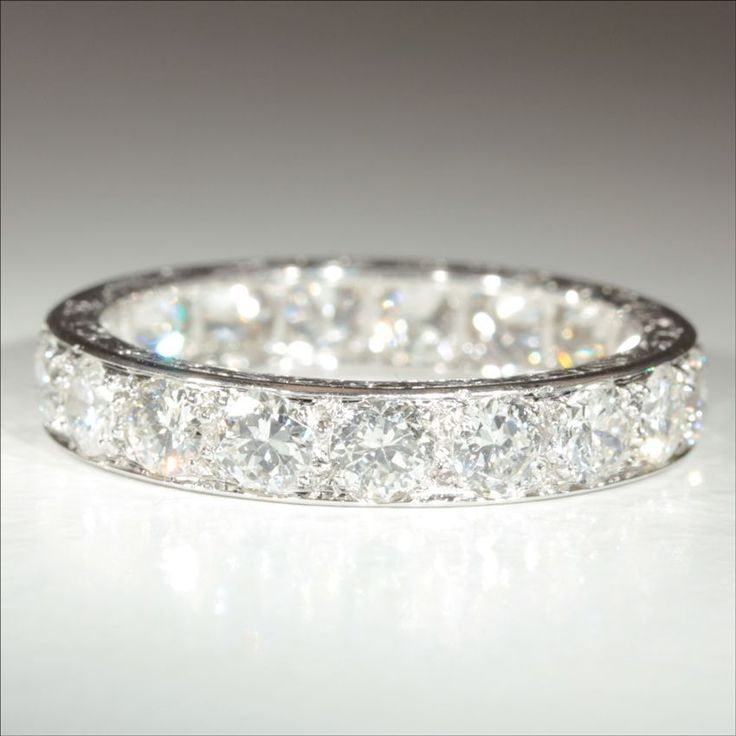 it's ONLY $16,000 . Crazy...but gorgeous. Vintage French Retro 3.8ctw Diamond Eternity Ring in Platinum c.1940