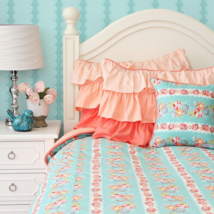 Coral and turquoise bedding features such charming sets for baby room decorating ideas. Girls and boys can have the color of bedding with neutral gender decor.