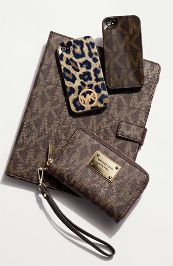Michael Kors...Stop it....I need all of this. Especially the leopard phone case cover.....Mmmm hmmm.
