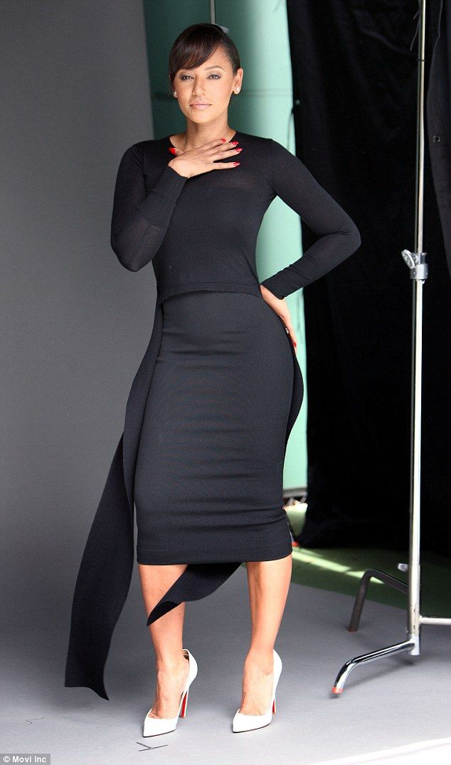 Stunner:Mel B, 40, proved to be picture perfect as she posed for a glamorous shoot in an array of elegant outfits