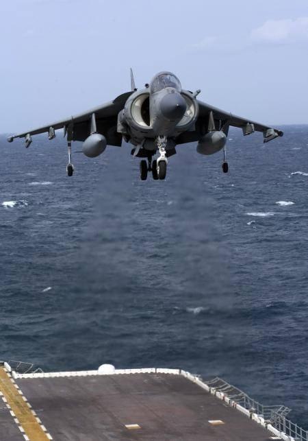 AV-8B Harrier II, prepares for landing on the flight deck aboard the amphibious assault ship USS Nassau