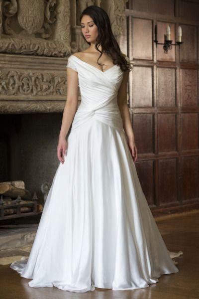 Augusta Jones off-the-shoulder wedding dress: http://www.stylemepretty.com/2014/10/27/9-swoon-worthy-off-the-shoulder-dresses/