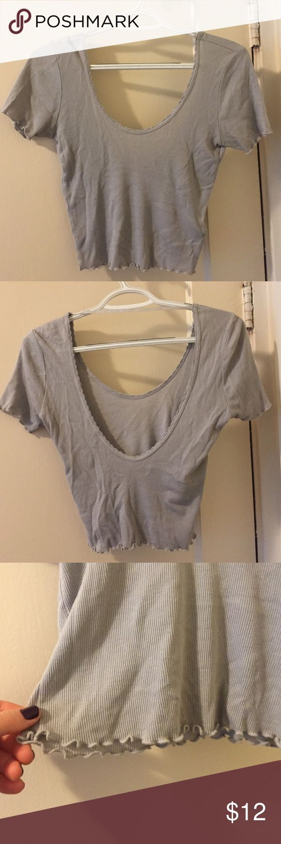 Super cute petite Crop Top Low hanging backside, strap on the top so it doesn't fall down your shoulders, ruffles on the bottom and on the arms and a cute embroidery for the neck/back lining, Gray-blue color but more to the gray side Tops