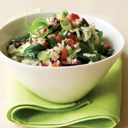 Mediterranean Rice Salad: 1. In a medium saucepan, bring 2 1/2 cups water to a boil. Add 1/2 tsp. salt and the rice. Turn heat to low, cover, and simmer 15 minutes. Remove from heat and let sit 5 minutes. Uncover and fluff with a fork.  2. In a large bowl, whisk lemon juice, olive oil, garlic, oregano, pepper, pepper flakes, and remaining tsp. salt.  3. Add rice to dressing and toss to combine. Add spinach, toss, and let sit until no longer steaming, about 20 minutes. Add remaining…