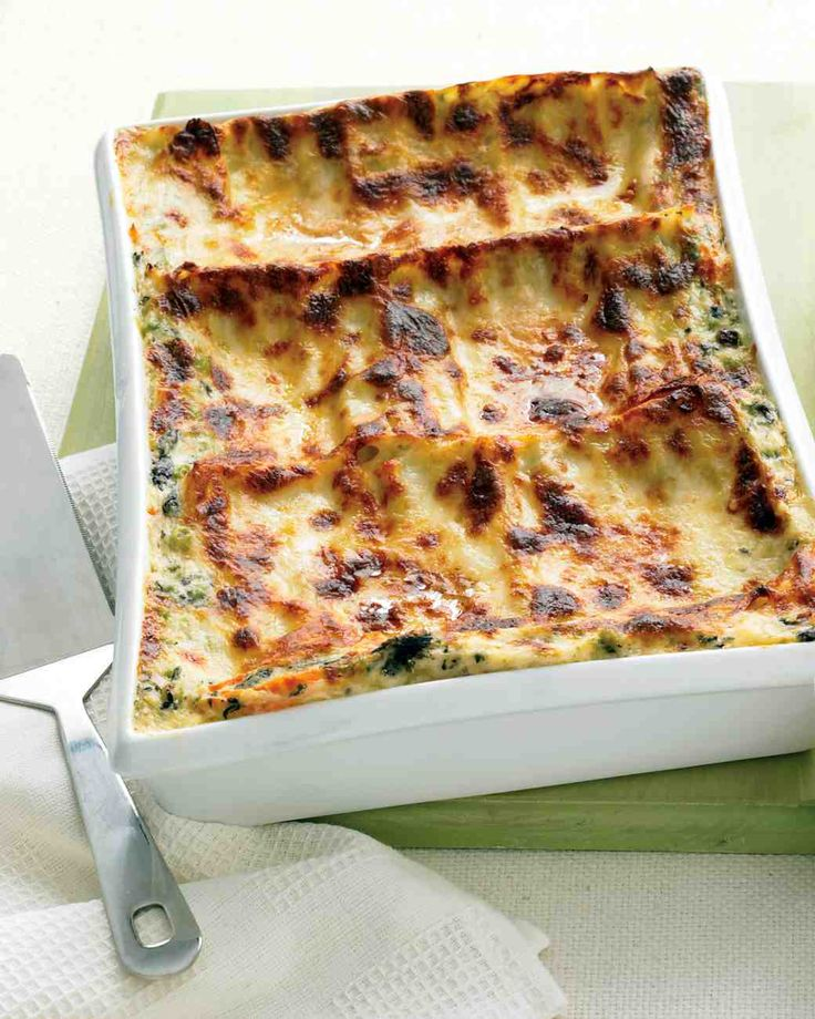 Freeze-Ahead Lasagna Primavera Recipe: Layered with delicate veggies, a creamy sauce, and three cheeses, this lasagna captures the freshness of spring -- straight from the freezer.