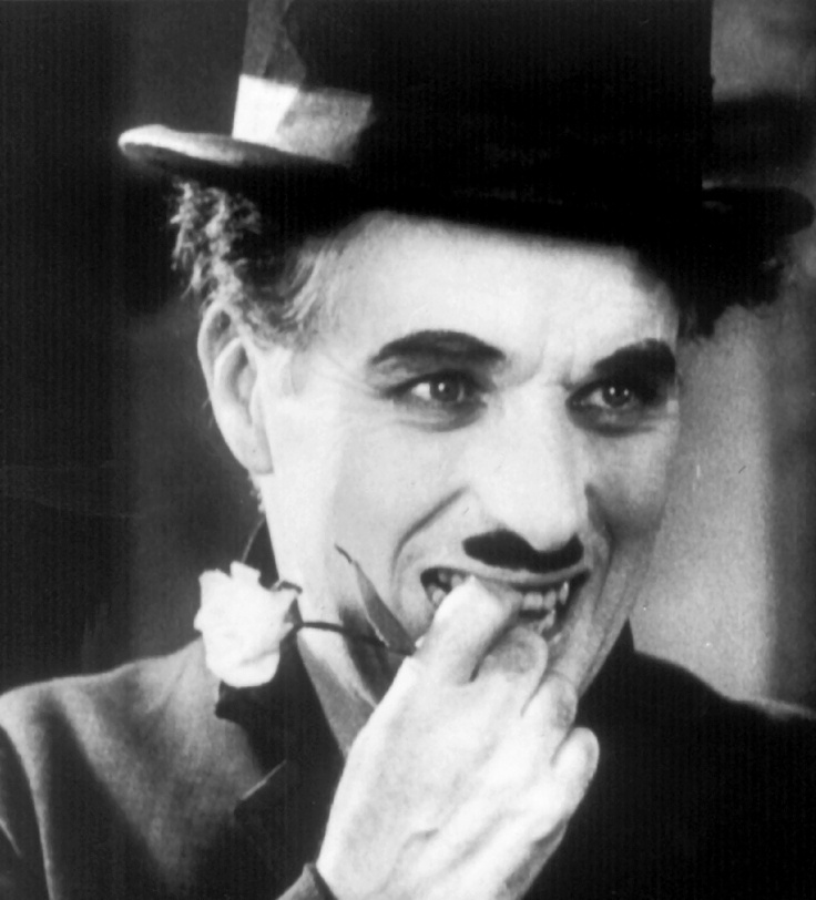 "Charles Chaplin: Sir Charles Spencer ""Charlie"" Chaplin, KBE (16 April 1889 – 25 December 1977) A Tramp, 1931, age 42."