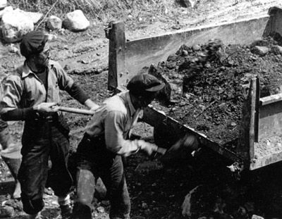 Japanese men working at an internment camp in 1942, two miles east of Schreiber, Ontario.