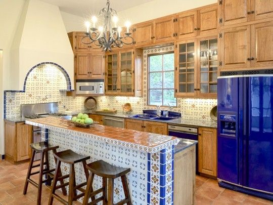 Home of the Week: A Chic Spanish Mansion in the Park Cities   The luxury kitchen is beyond fabulous with no detail spared in creating an authentic European atmosphere; custom cabinetry, a fantastic custom tiled oven hood, and a cobalt blue fridge all tied together by Mediterranean style kitchen tile in white, rustic gold, and cobalt blue. ~ 3204 Beverly Drive