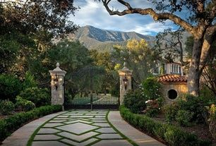 Mediterranean Landscape/Yard with Iron entry gate, Driveway, Stone and concrete pillars, Grass and concrete driveway design