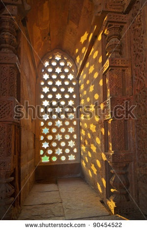 stock photo : Qutb Minar, Delhi, carvings in the sandstone of a window gives a pattern of sky with stars