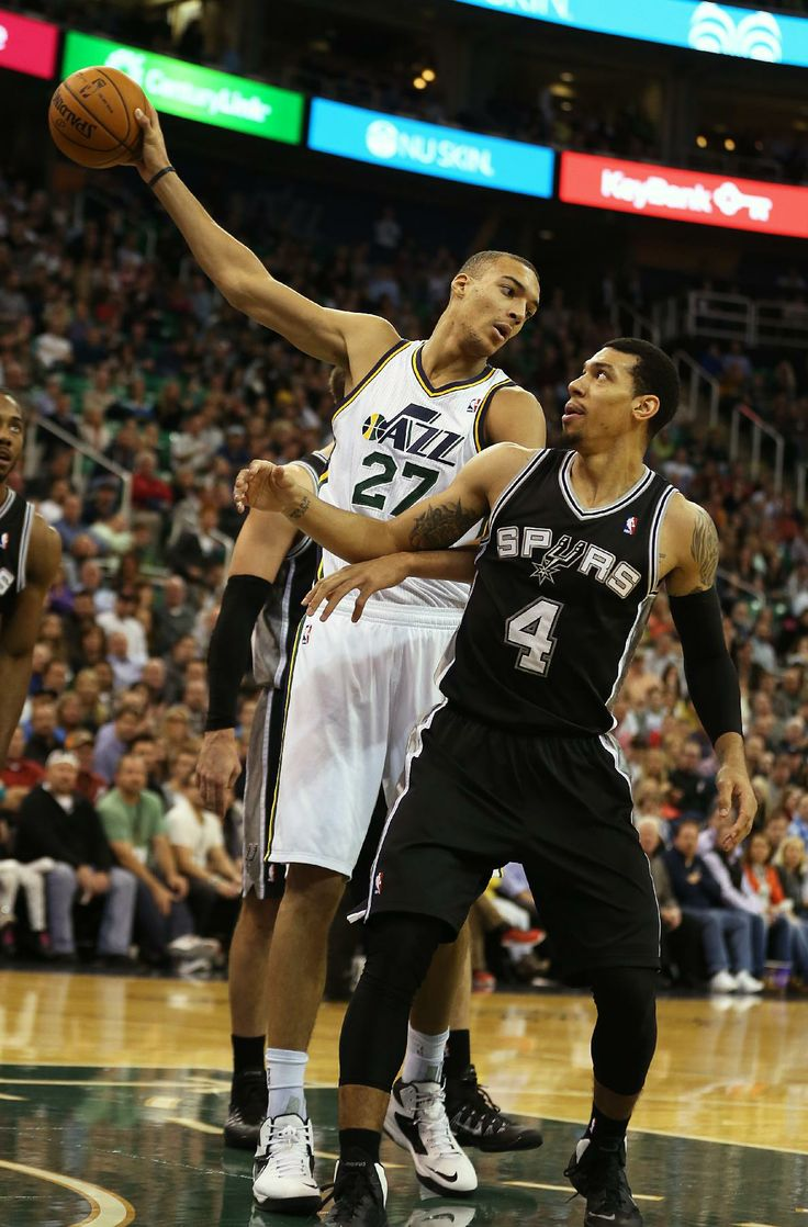 Utah Jazz's Rudy Gobert, left, holds the ball away from San Antonio Spurs' Danny Green during the second half of an NBA basketball game in Salt Lake City, Friday, Nov. 15, 2013. The Spurs won 91-82. (AP photo/George Frey)