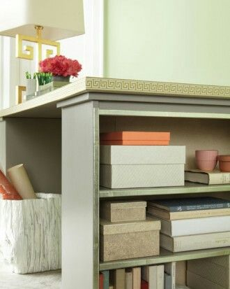 Thirty-inch square bookcases are the ideal height for a desk and are the same width as a standard-size door. Prime and paint the bookcases and door in the same color. To give the desk a finished, cohesive look, add a few details: Line the back of the shelves with marbled paper (secured with double-sided tape) and hot-glue a ribbon around the edge of the desktop.