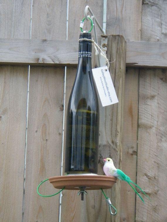 What a great idea! Wine bottle bird feeder. Etsy.com ~ GalleyWestStudio. $29
