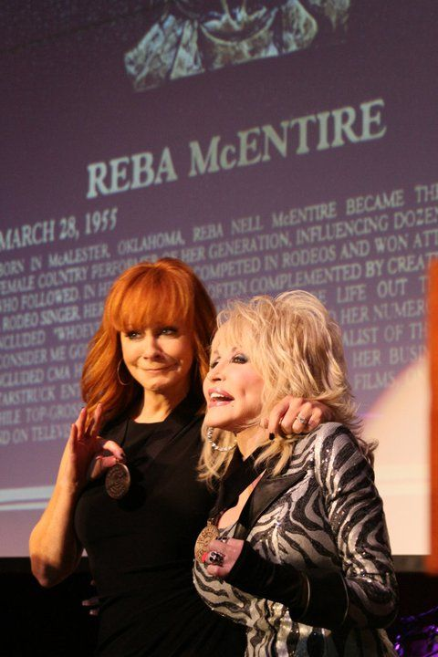 reba and dolly --reba being presented into country music hall of fame QUEEN OF COUNTRY MUSIC 2011