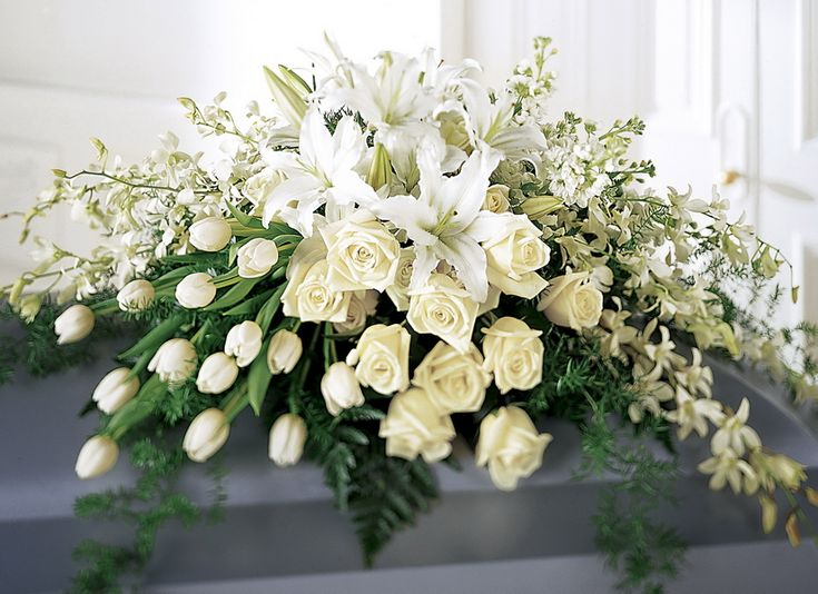 white funeral casket flowers, you never know when God will call you but I found this serene and peacefull