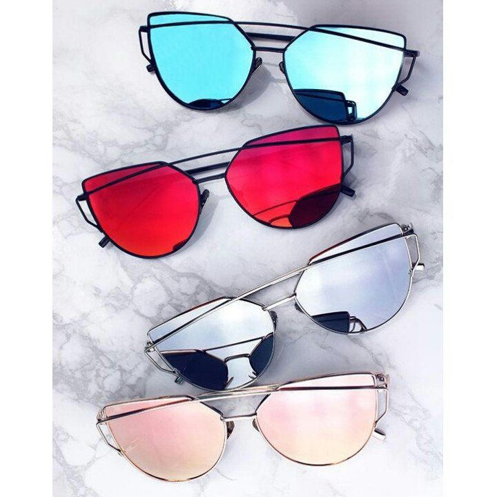 Take your look to the next level with this season's must-have accessory. These sophisticated oversize aviator sunglasses are designed with teardrop-shaped, color mirror flat lenses and a sleek thin me