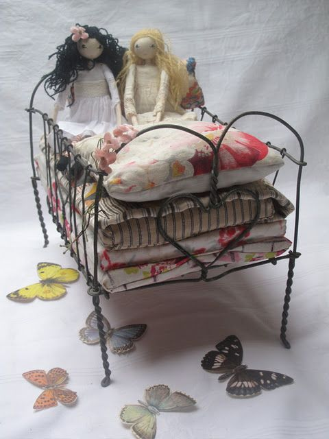dolls and wire bed