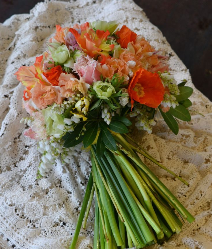 Peachy tones with a vintage vibe...poppies, daffodils, anemones, blushing bride, French tulips and andromeda