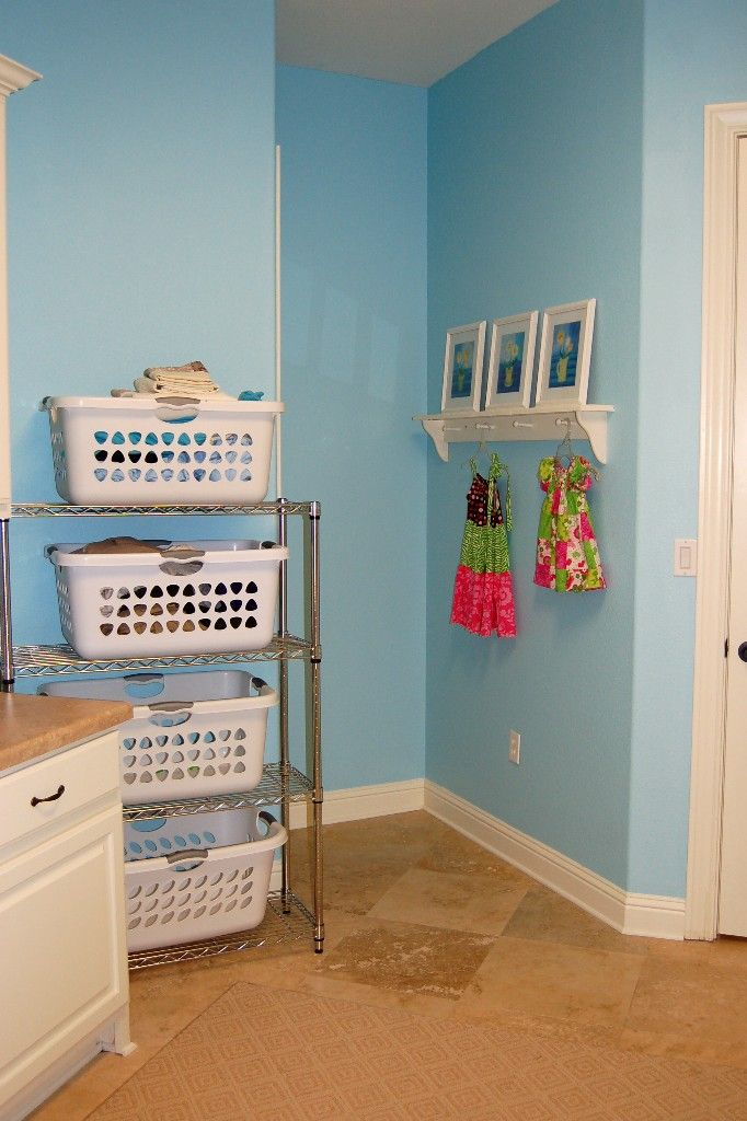 Love it! Quick solution to the laundry basket idea without having to build it from wood and paint it.