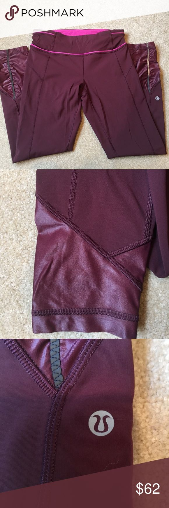 Lululemon Pace Queen Tights My first lulu's! Nothing wrong just opening space for new pieces! Time to let them go to a new home. Bordeaux raspberry color with pink contrast along the waistband. Reflective strips on the legs. 7/8 length and size 6. No trades and the price is firm. 🍋 lululemon athletica Pants Leggings