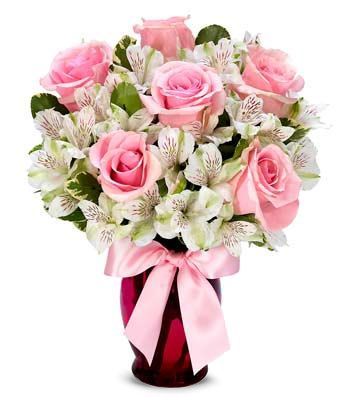 Sweet as Pink  $52.99  Sophistication gets new meaning as pink roses and white alstroemeria elegantly fill a pink fluted glass vase accented with a pretty pink bow.