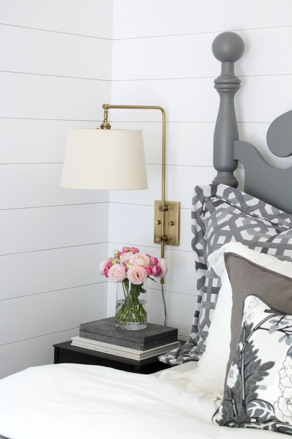 LOVE this swing arm sconce used in this master bedroom makeover - shade swings and pivots for easy reading in bed!