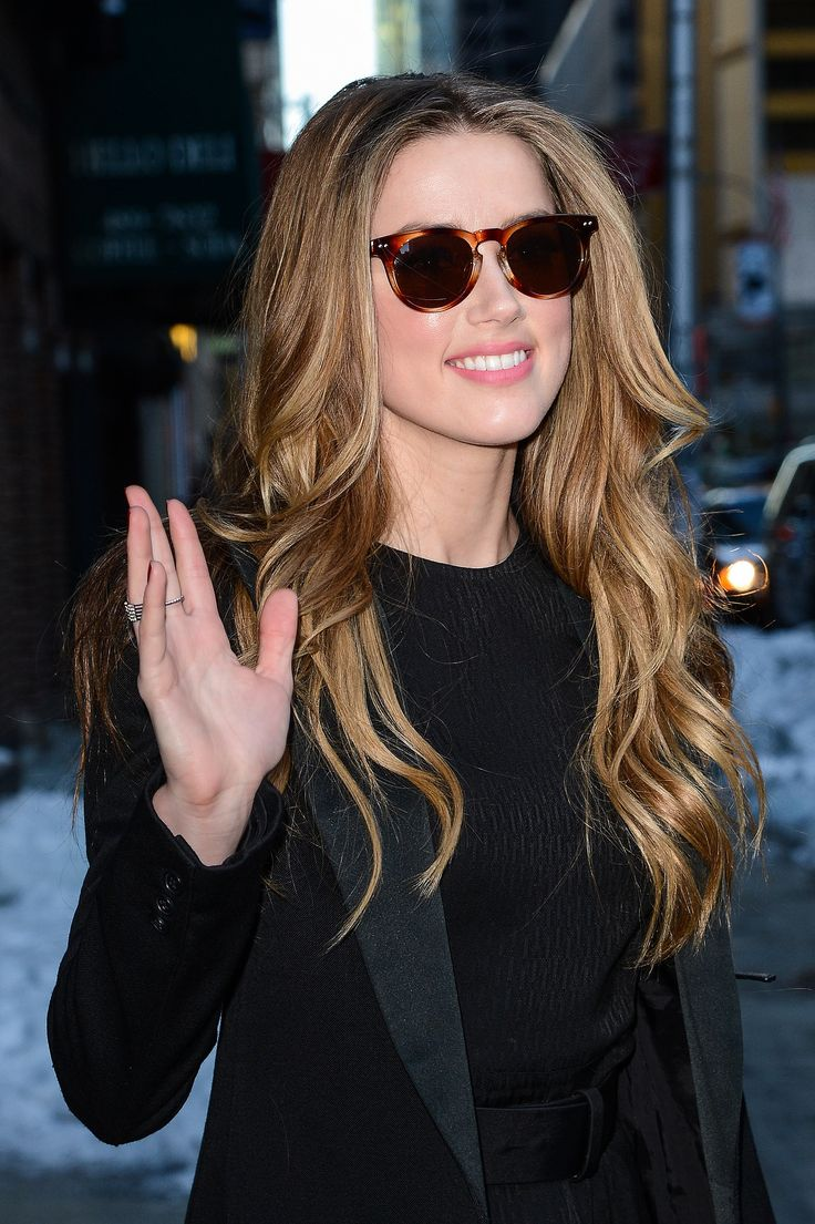 Amber let her long locks loose for her appearance on the Late Show With David Letterman.