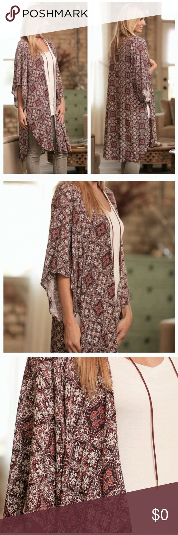 Moroccan Kimono Top Beautiful kimono top.  It is white,  rust and black with slits on both sides.  Wear it with your favorite skinny jeans or leggings! Tops