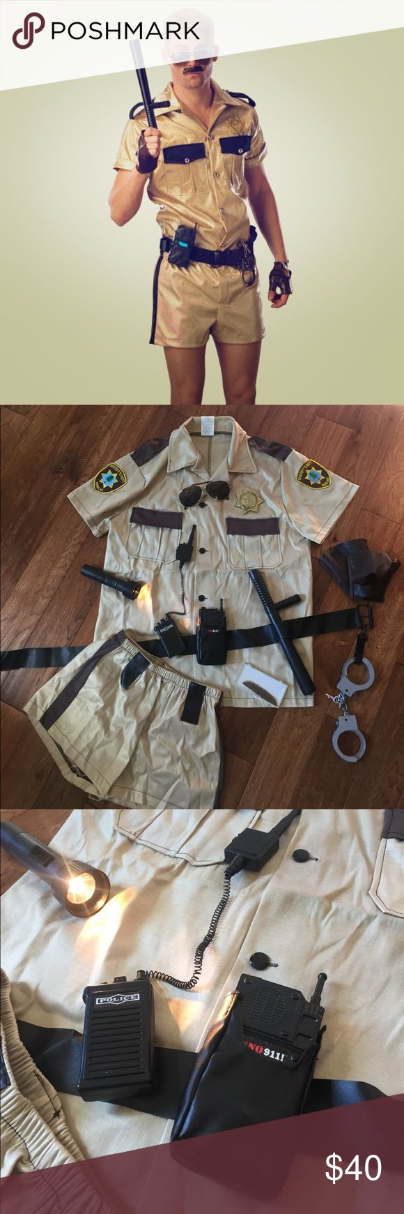 LT. Dangle Reno 911 Halloween Costume This was hands down the most funny costume my husband has ever worn!  I would never sell it if I knew I could get him to wear it again. Pair w/ a jockstrap underneath to bring it to the next level.  Size medium, fits up to 44 jacket size. Includes shirt, shorts, badge, mustache to adhere, utility belt that includes several misc items in picture, gloves (one has a slight tear), a working flashlight (batteries not included for shipping purposes) and a pair…