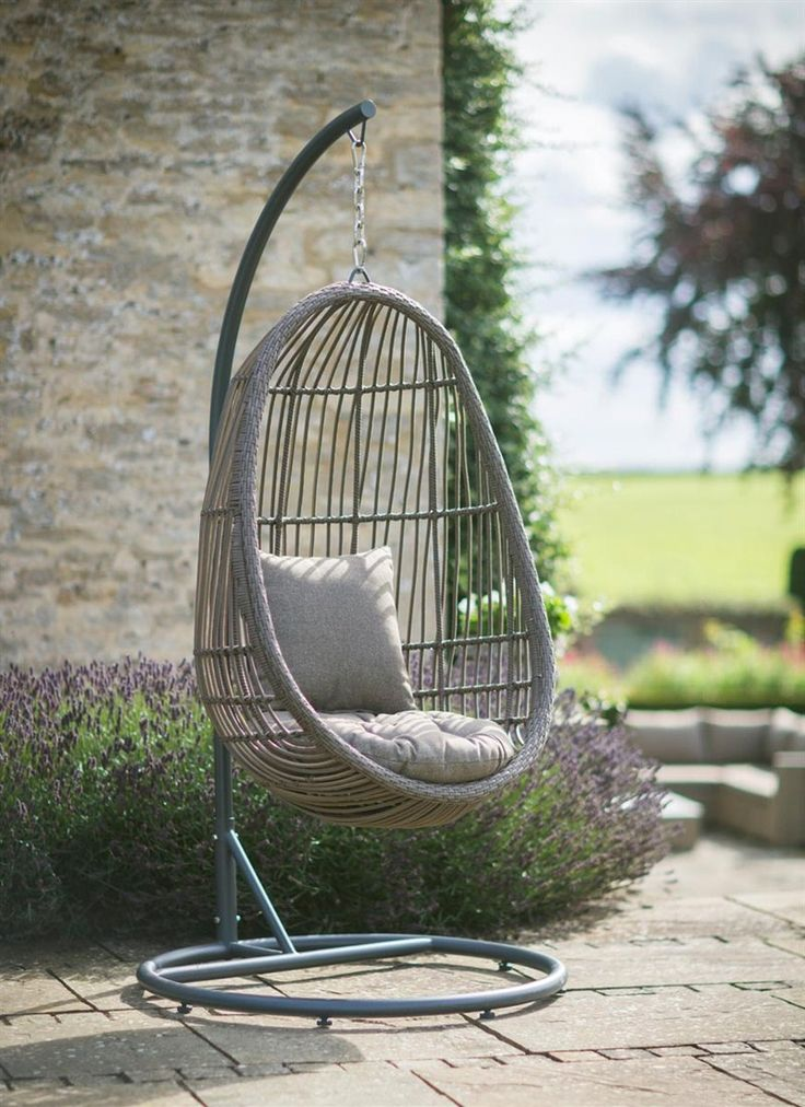 our rattan nest chair comes with its own stand so your can relax anywhere in the chair swinggarden