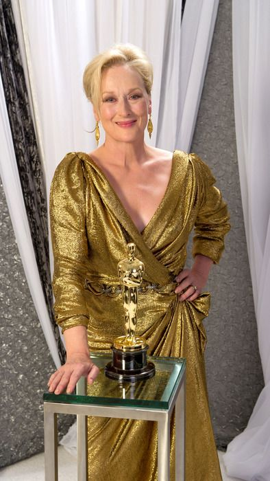 """2011 MERYL STREEP Meryl Streep posing with her third Oscar, won for her work in the movie """"The Iron Lady"""" """"IMeryl Streep could play Batman and be the tight choice. . she is perfection"""" Quote from Cameron - Modern Family."""