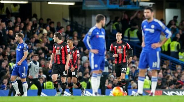 Football Soccer - Chelsea v AFC Bournemouth - Barclays Premier League - Stamford Bridge - 5/12/15 Bournemouth's Glenn Murray celebrates scoring their first goal as Chelsea's Diego Costa and Eden Hazard wait to kick off Reuters / Suzanne Plunkett