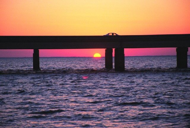 The Lake Pontchartrain Causeway Bridge stretches 24 miles from New Orleans to St. Tammany Parish, Louisiana. The two parallel bridges are supported by 9,500 concrete pilings and feature bascule spans over the navigation channel 8 miles south of the north shore. The southern terminus of the Causeway is in Metairie, Louisiana, a suburb of New Orleans. The northern terminus is at Mandeville, Louisiana.