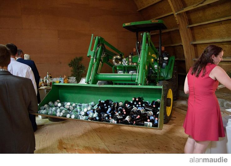 Beer in a tractor. Calgary Rustic Ranch Wedding Photography