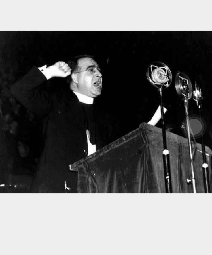 <Pin> This is a picture of Father Charles Coughlin. He used the radio to help spread religion. He became nationwide famous in doing so. He saw the that the populate realigning was experiencing a feline in attendance.