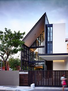 HYLA Architects have designed 'Lines of Light', a 2 storey corner terrace house with an attic in Singapore.