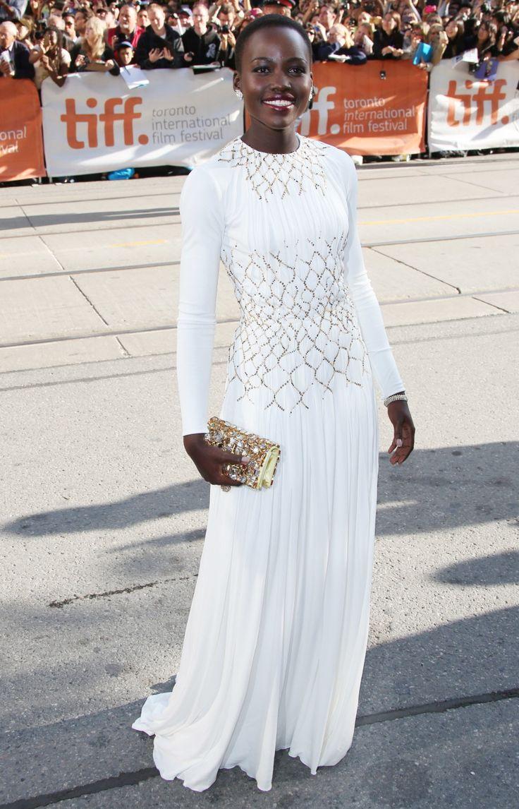 Lupita Nyong'o in a Prada silk jersey gown, ...