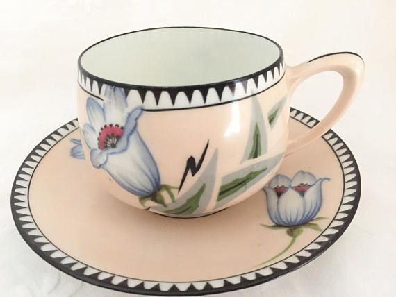 pink porcelain teacup and saucer, this RS Germany set with white flowers and red centers
