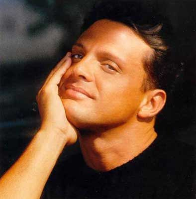 A young Luis Miguel...had such a big crush on him back in the early 90s...  Still love his voice.
