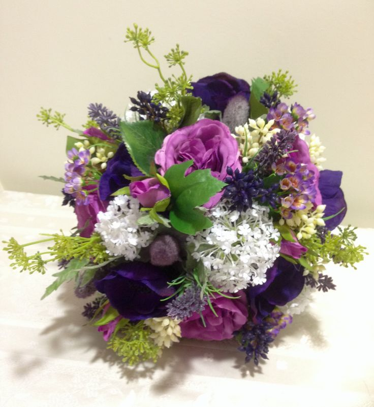 Bouquet in everlasting flowers. Cabbage roses, anemones, lavender,snowball, berries. Shades of purple and ivory's.
