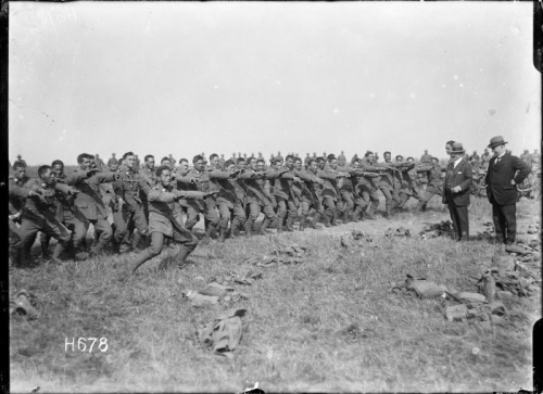 New Zealand Maori Pioneer Battalion members perform a haka for Cabinet minister Sir Joseph Ward at Bois-de-Warnimont, 30 June 1918. The haka introduced Maori custom and practice into the New Zealand armed services, and the use of these customs and practices grew during the conflicts of the 20th century.