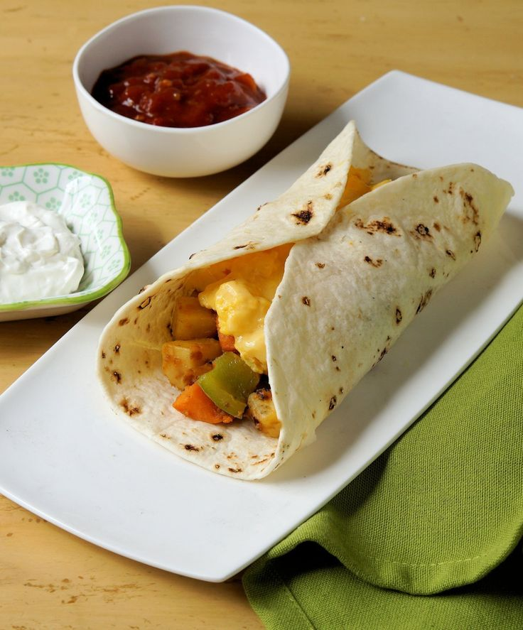 I'm not sure why I call these breakfast burritos because I like them for dinner. http://www.cautiousvegetarian.ca/recipe/breakfast-burrito/