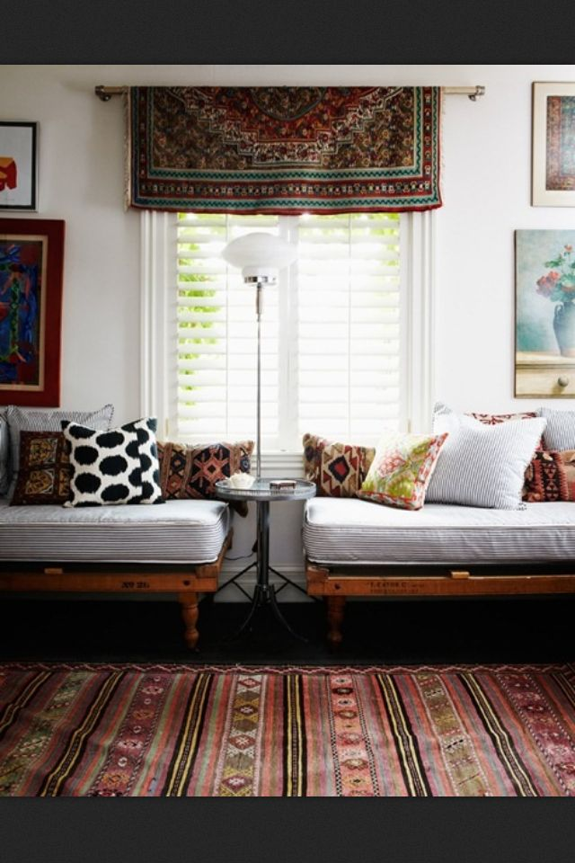 .The colors! The rug hanging as a valance. Simple, stunning use of color and pattern.