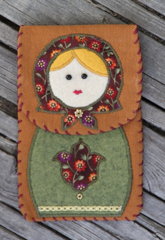 Could try with felt...  Matryoshka Cell Phone Cover Sienna. $9.00, via Etsy.