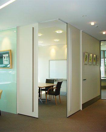 Full-Height corner meeting pocket doors