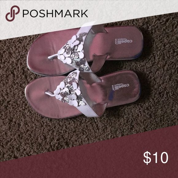 Weekend sale! Dressy Flip flops These flip flops look almost like new! Have silver sparkly and white butterfly's on them. They are NOT purple even tho in the pic that's what they look like Shoes Dress Shoes