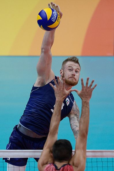 Italy's Ivan Zaytsev spikes the ball during the men's semifinal volleyball match…