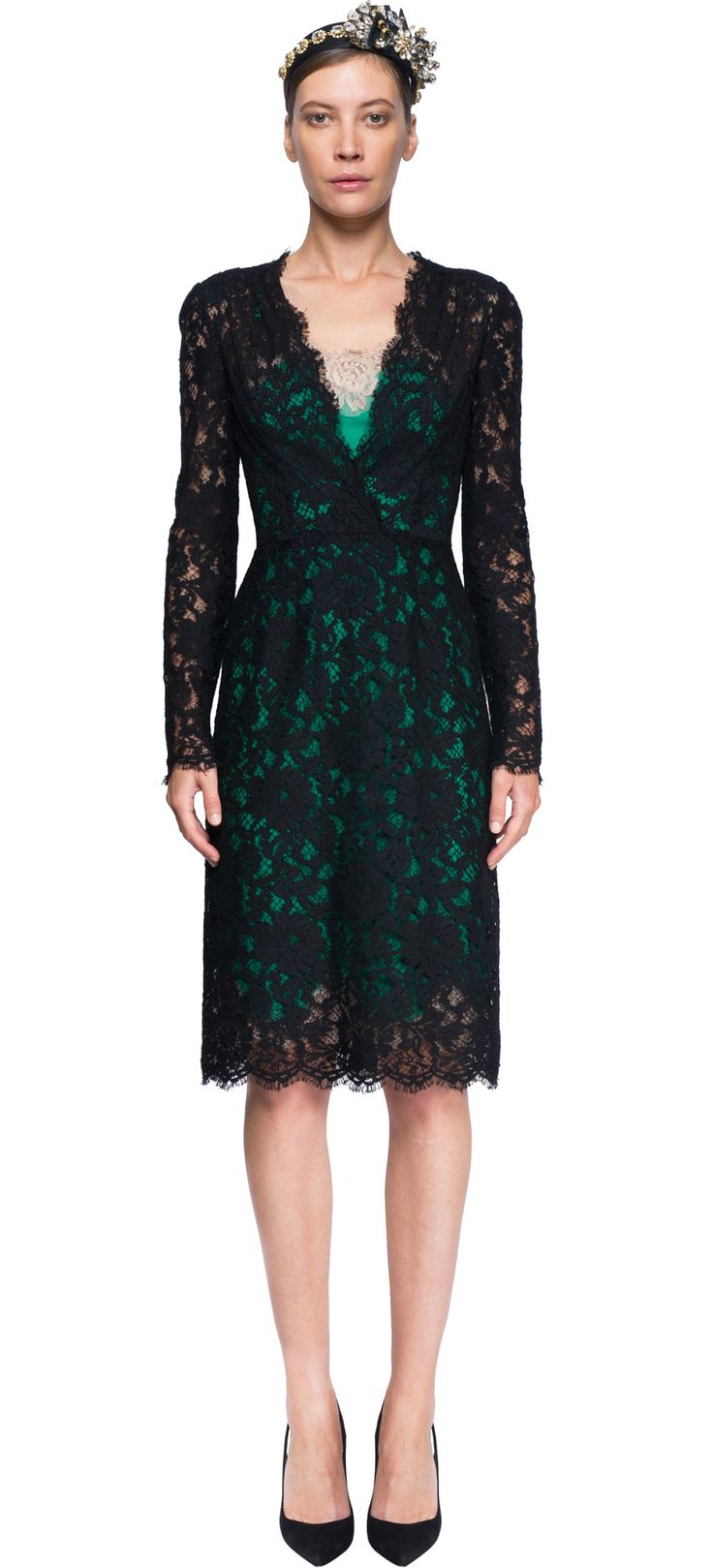 Synonymous with timeless and refined sensuality, the lace is one of the fil rouge that binds together all the Dolce & Gabbana collections. Designed to sit on the waist, this long floral lace cocktail-dress features scalloped edges and v-neck. To cover the sheer fabric, this dress comes with with a stretch green camisole embroidered with a floral element.