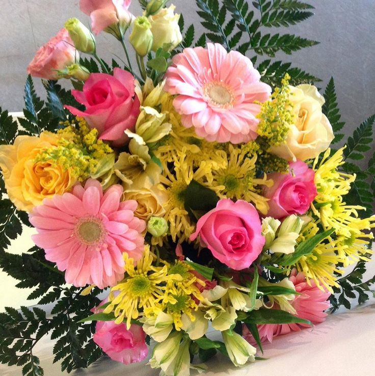 A super fresh Spring bouquet. I love the combination of yellow Mums and pink Gerberas and Roses.
