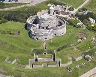 St Mawes Castle and its larger sister castle, Pendennis, were built as part of a defensive chain of fortresses by Henry VIII to protect the south coast of Cornwall, England, United Kingdom. This chain of coastal fortifications are known as Henrician Castles or Device Forts. St Mawes Castle was built between 1540 and 1543, halfway down the hillside on the eastern shore of the River Fal estuary to provide protection to the large inland expanse of water known as the Carrick Roads, near…